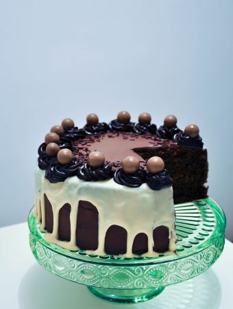 Daim and maltesers chocolate cake with white chocolate ganache drip