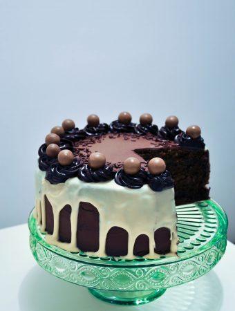 Daim and maltesers chocolate cake with white chocolate ganache drip