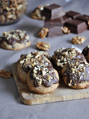 Chocolate and walnut cookies on a wooden desk