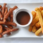 Fried and baked churros with chocolate sauce