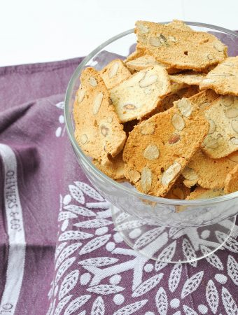 Thin almond biscotti in a glass bowl