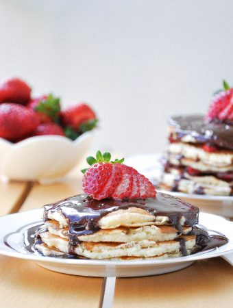 Fluffy American Pancakes stacked with hazelnut spread