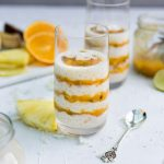 Coconut Tapioca Pudding with Passion Furit, mangoes,, pineapple and citrus sauce in a glass
