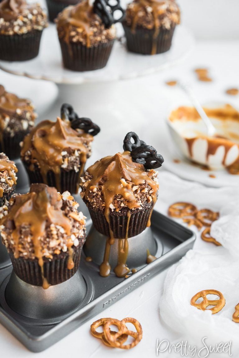 Chocolate caramel cupcakes with chocolate pretzel butterfly and drizzled caramel