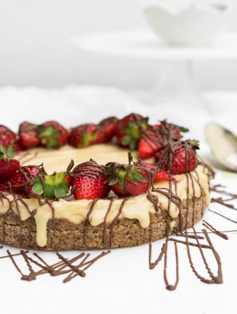 Chocolate cheesecake with strawberries on top and drizzled chocolate