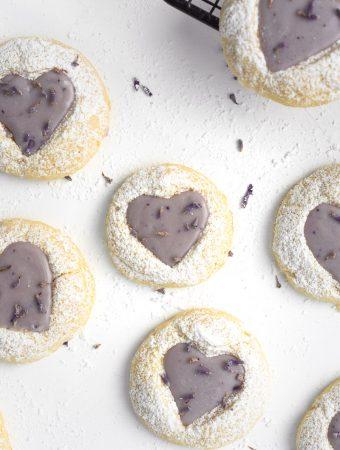 Close up of a lemon thumbprint cookie with a lavender ganache