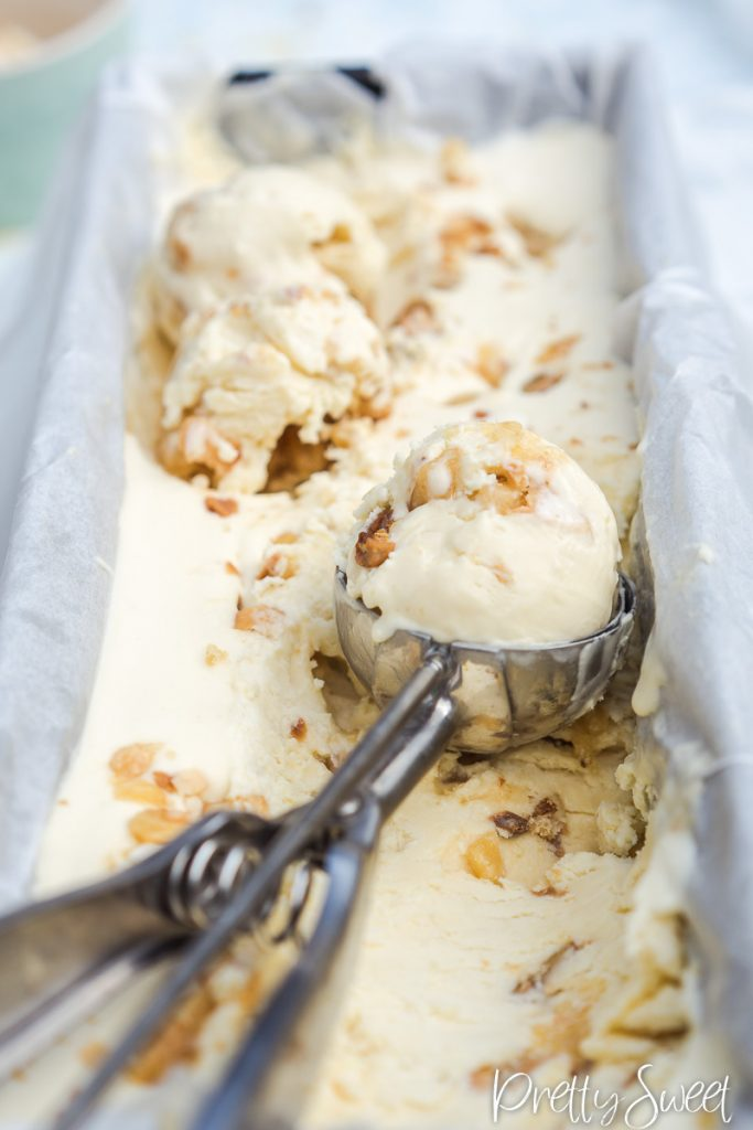 close up of no-churn macadamia brittle ice cream with a scoop inside an ice cream scooper