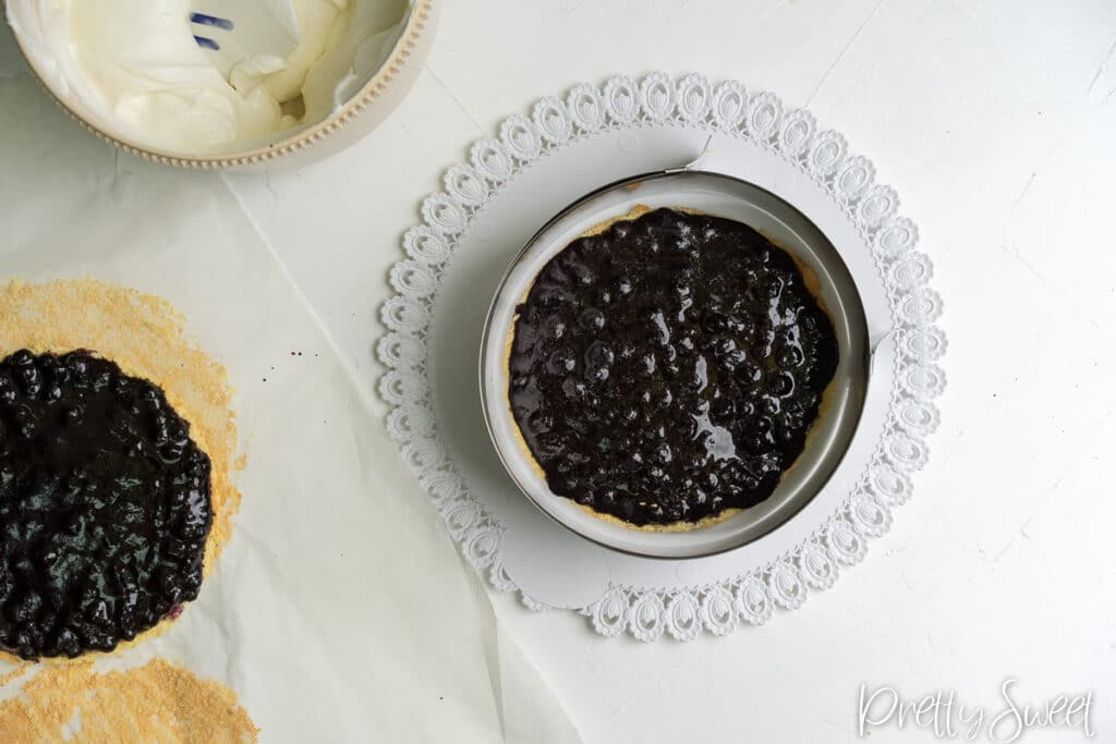 Blueberry gelee on a sponge in a round cake tin