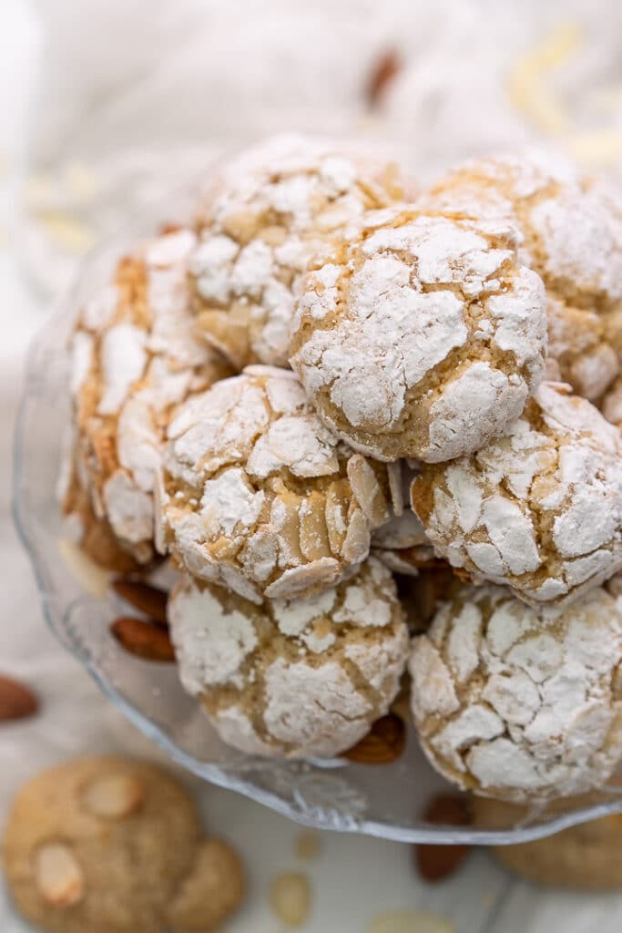 Round almond cookies on top of each other on a cake stand