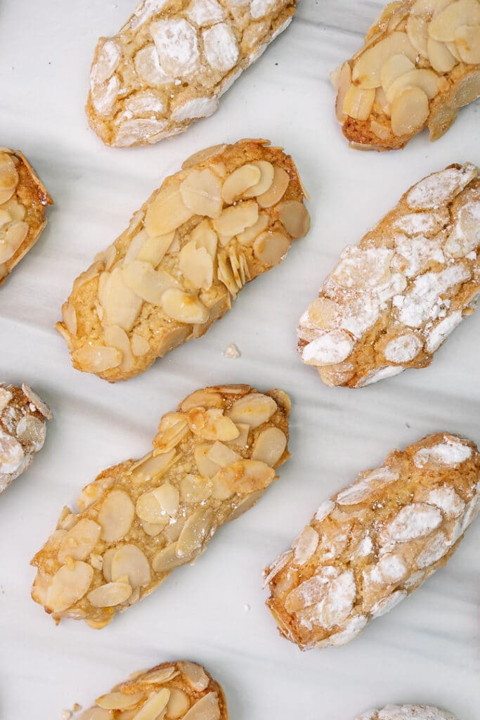 oval amaretti cookies lined in a pattern on a marble table from birds perspective