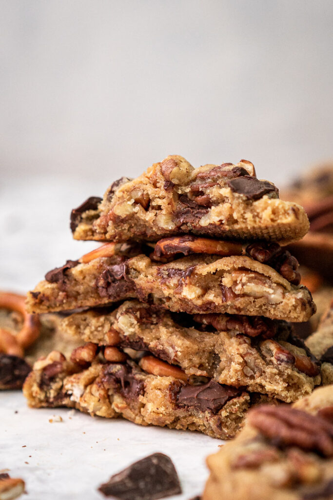 2 halved maple syrup pecan cookies in a stack up close