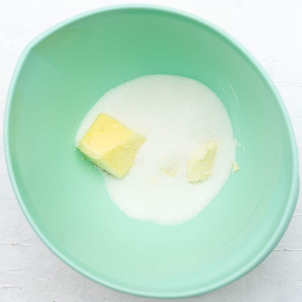 butter and sugar in a turquoise bowl