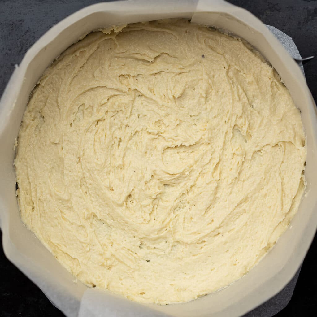 spread cinnamon roll batter over the lined bottom of a pan