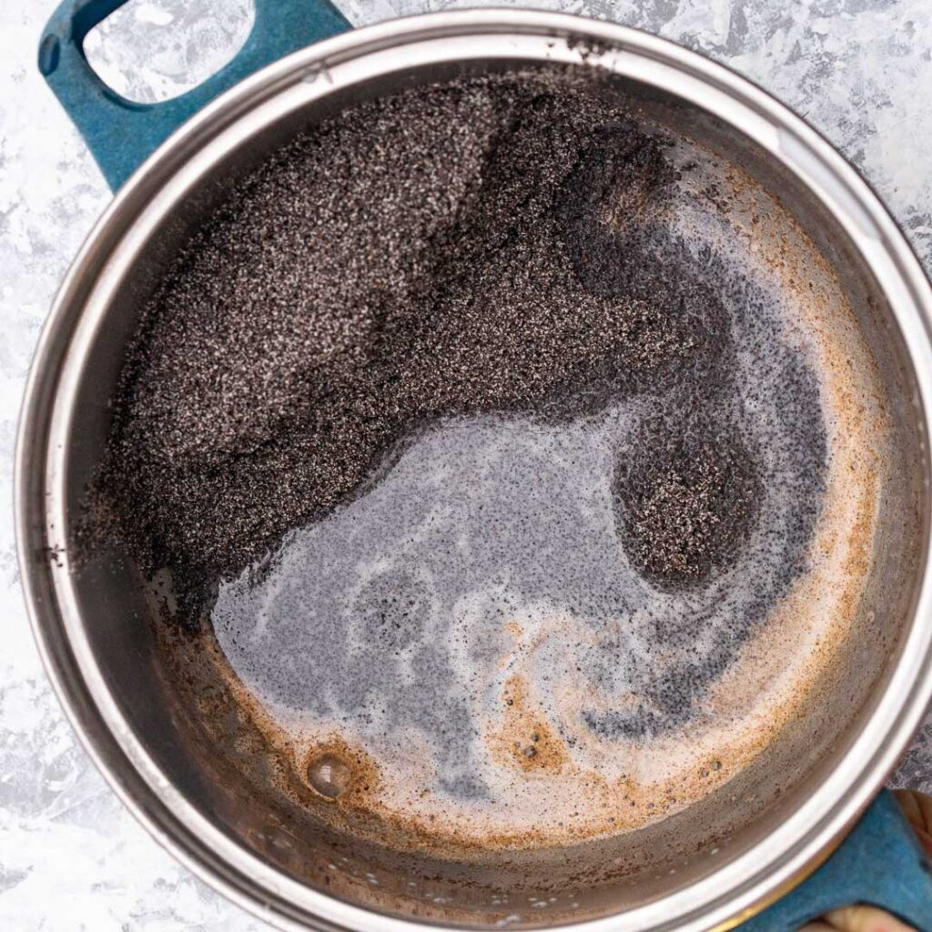 poppy seeds and cinnamon milk in a pot