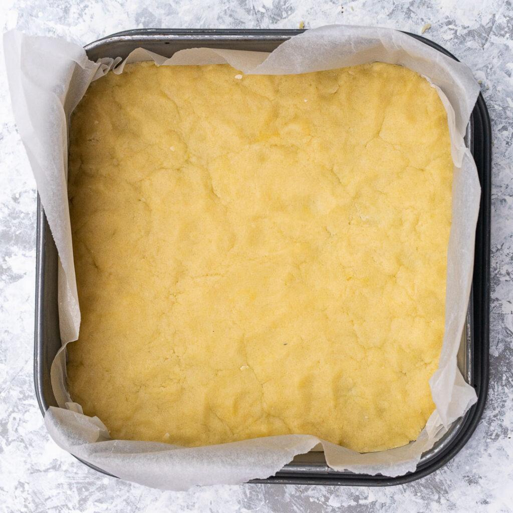 dough on the bottom of a baking pan